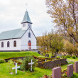 Cemetery and church in Iceland — Stockfoto #38642485