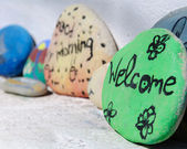 """Welcome"" Text Written on the painted Stone — Stock Photo"