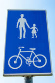 Road sign for pedestrians and cyclists — Stock Photo