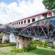 "Kanchanaburi, Thailand - May 23, 2014: Train on the bridge over river Kwai in Kanchanaburi province, Thailand.The bridge is famous due to the movie ""The Bridge on the River Kwai"". — Stock Photo #48478513"