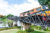 "Kanchanaburi, Thailand - May 23, 2014: Train on the bridge over river Kwai in Kanchanaburi province, Thailand.The bridge is famous due to the movie ""The Bridge on the River Kwai"". — Stock Photo"
