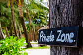 Private zone sign standing for private property restricted access — Stock Photo
