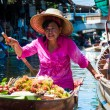 Thai locals sell food and souvenirs at famous Damnoen Saduak floating market in Thailand, in the old traditional way of selling from small boats. — Stock Photo #50298819