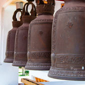 Row of hanging buddhist religious bells in Thailand temple — Stock Photo