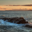 Sunset, wide shot panorama, ocean landscape over sea with rocks. — Stock Photo