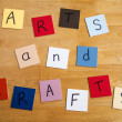 Arts and Crafts in letters on square tiles as poster / sign. - Stock Photo