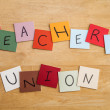 Stock Photo: Teachers Union poster in letters on square tiles - education.