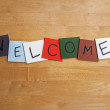 WELCOME written in letters on color tiles - public services / relations, education, business, editorial etc. - Stock Photo