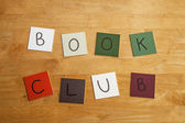 Book Club in letters / words on square tiles as poster - education / literary / publishing / libraries / schools. — Zdjęcie stockowe