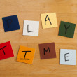 Play Time written on colored tiles - education, schools, teaching, editorial. - Stock Photo