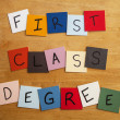 'First Class Degree' in letters on tiles - Education, Teaching, Editorial, Lecturers, Univeristy - Stock Photo