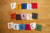 'First Class Degree' in letters on tiles - Education, Teaching, Editorial, Lecturers, Univeristy — Stock Photo