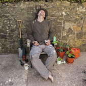 The Grubby, Snoozing, Happy Gardener. — Stock Photo