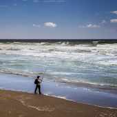 Sea Angler at the Surf on the Sea Shore. — Stock Photo