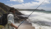 Fisherman Portrait, with Fishing Rod on the Cliffs. — Stock Photo