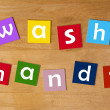 Wash hands ! - word sign for school children. — Stockfoto