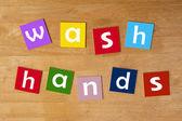 Wash hands ! - word sign for school children. — Stock Photo