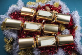 Christmas Crackers with blank labels - red, gold, silver and gre — Stock Photo