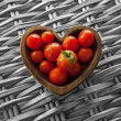 Tomatos in Wooden Heart Shaped Bowl — Foto de Stock