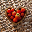 Tomatos in Wooden Heart Shaped Bowl — Stock Photo