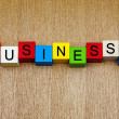 Business - sign on building blocks — Stock Photo
