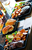 Crusty Bread Rolls - focus on the the baps, amid steak and chips — Stock Photo