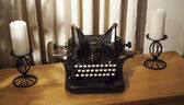 Antique typewriter on cabinet with candles — Foto Stock