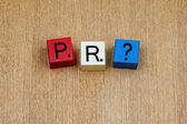 PR, sign series for business and public relations. — Stock Photo
