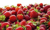 Strawberries tumbling, close up. — Stock Photo
