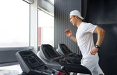 Man in fitness center — Stock Photo