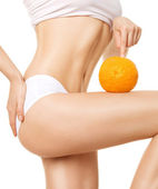 Female body with orange — Stock Photo