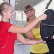 Two blonde women in Fitness-Studio - Stock Photo