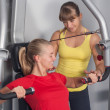 Two blonde women in Fitness-Studio — Stockfoto #17215383
