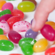 Take a colored bean candy — Stock Photo #17215461