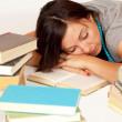 Bookworm sleeps on books — Stock Photo