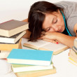 Bookworm sleeps over her books — Stockfoto