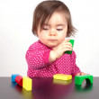 Child play with bricks — Stock Photo