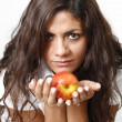 Women show an apple in her hands — Stock Photo
