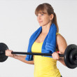 Blonde women with barbell — Stok Fotoğraf #17216833