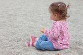 Cute baby sit in gravel — Stok fotoğraf