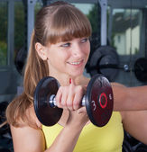 Personal trainer with dumb bell — Stock Photo