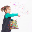 Cute Girl throw confetti — Stock Photo