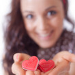 Girl with hearts in her hand - Stock Photo
