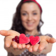 Girl with hearts in her hand — Stock Photo