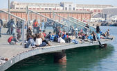 People in Barcelona harbor — Stock Photo