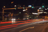 Long exposure shot of a busy street at night — Stock Photo