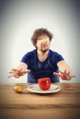 Blindfolded man wants to taste vegetables — Stock Photo