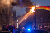 WARSAW, Poland, Monday, 11th Nov 2013. Art installation The Rainbow in Savior Square burns during Polish Independence Day. The rainbow was set on fire during Independence March. — Stock Photo