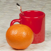 A cup for coffee, spoon and mandarin — Stock Photo