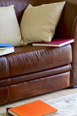 Couch, pillows and books — Stock Photo